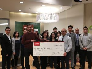 CACV Executive Director Eric Rhys Miller with Program Manager Johnny Trinh with Vancity Chinatown branch manager Grace Wong and staff